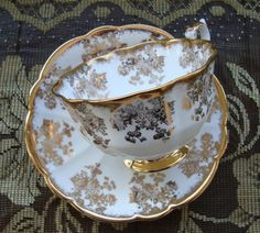Royal Albert Bone China England - Vintage Tea Cup and Saucer - Avon Cup with Gold Floral Scrolls and Brushed Gold Trim by OfftheShelf2015 on Etsy
