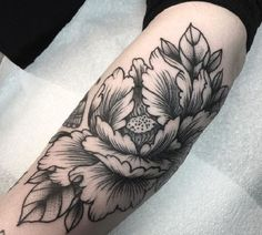 Another peony tattoo, that can blow your mind off is the deep colored peony tattoo, that best can expose in shades of black. this peony tattoo is the signature of saturated love, that you can also have on your thigh or arm for classy yet sexy look.