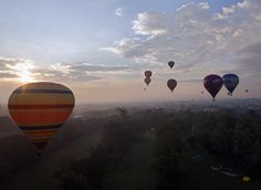 Hot air balloons fly over the sky in Chiang Mai province, northern Thailand, December 6, 2014. The two-day International Balloon festival 2014 featuring balloon pilots from Germany, Spain, Netherlands, Britain, and Czech Republic is held on December 06-07 2014 to celebrate Thai King Bhumibol Adulyadej's 87th birthday and also aimed to promote the tourism industry in Chiang Mai northern city. (EPA/PONGMANAT TASIRI)