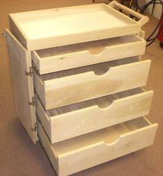 A cart like this is a cool way to store craft supplies, clothes and many other things! They have plastic ones ,too, that roll and have more drawers.
