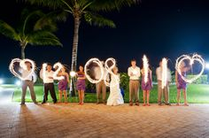 Long exposure wedding party wedding date photo. This is a really good idea.