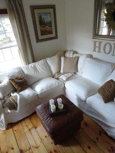 Ikea Ektorp sofa blekinge white beige cowhide rug white & wood neutral living room black