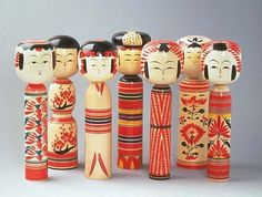 Kokeshi (こけし kokeshi), are Japanese dolls, originally from northern Japan. They are handmade from wood, have a simple trunk and an enlarged head with a few thin, painted lines to define the face. The body has a floral design painted in red, black, and sometimes yellow, and covered with a layer of wax. One characteristic of kokeshi dolls is their lack of arms or legs. The bottom is marked with the signature of the artist.