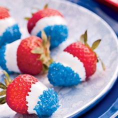 4th of July. Strawberries with white chocolate or frosting and blue sprinkles