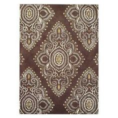 Tufted New Zealand wool rug with a Persian-inspired motif. Made in India.  Product: RugConstruction Material: WoolColor: Brown and ivoryFeatures:  Made in IndiaHand-tufted Cleaning and Care: Professional cleaning recommended