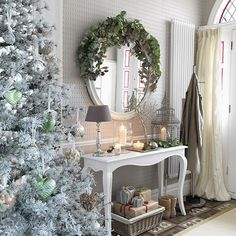 White hallway with white console table and metallic decorations