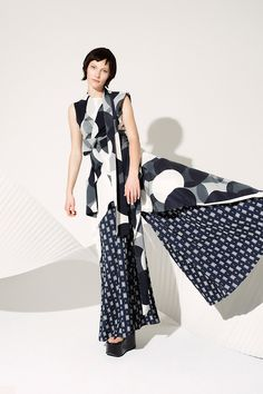 Mixed prints emphasize the flare on this @Sass_and_bide look #LFW #SS15