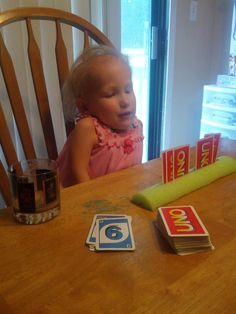 Pool noodle card holder for young children or children with disabilities. We plan on playing a lot of board/card games with our children and I'm sure this will come in handy.