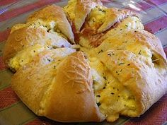 crescent rolls, eggs, bacon, cheese