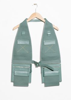 Front image of Stories utility body vest in green