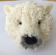 The Homemade Haven loves this Pom Pom Polar Bear inspired by Trikotri. Add a cute ribbon and it would look stunning on a Christmas tree