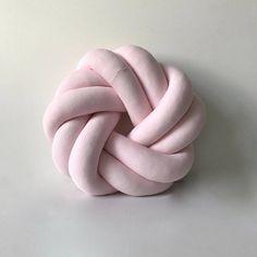 El círculo redondo bebé nudo rosa cojín almohada
