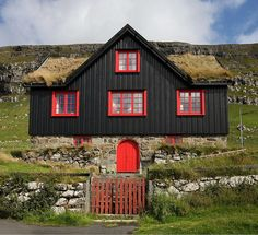 Travel Inspiration for The Faroe Islands - Black house red windows grass roof - the stereotypical Faroese building. This one is located near the old cathedral SW of Tórshavn Faroe Islands. Red Windows, Pintura Exterior, Roofing Options, Residential Roofing, Cabins And Cottages, Faroe Islands, Exterior Colors, Exterior Paint, Black House