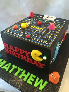 Pacman Birthday Cake Pacman birthday cake made to mimic the electronic game. All decorations made out of a modeling chocolate/fondant mix....