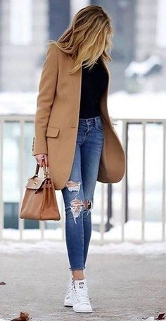 Camel coat over black top and jeans.