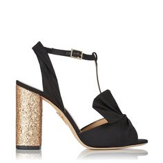 Odelle combines shiny glitter and elegant drapery to create an exquisite party shoe. In black silk with a gorgeous fan detail, this T-bar sandal is an evening wardrobe must-have. |Charlotte Olympia