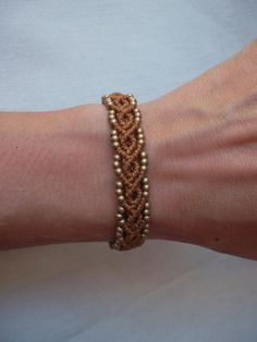 Macrame bracelet made with resistant waxed thread & brass beads... adjustable.... If you like this model of bracelet but in another color i made it for you.... write me in facebook https://www.facebook.com/groups/278704982310-Lunatic Hands by Maria Tolon