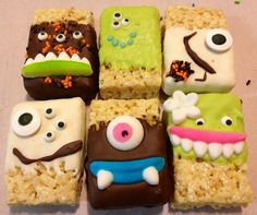 Monster Krispy Treats, or as my dear little friend called them, Cookie Monsters. Store-bought Rice Krispy Treats dipped in Almond Bark or Candy Melts, decorated with monster eyes, mouths, and sprinkles from ABC Baking Company in Phoenix. They were a hit!
