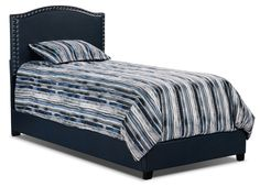 Give your bedroom a lush look with this Benjamin bed. Built with durable rubberwood, this bed is both eco-friendly and sturdy enough to last through many a good night's sleep. Sleek vinyl covers all parts of this bed, and the navy blue colour adds a delightfully bold statement. Outlined in copper nailhead accents, this bed will make a stunning complement to decors both modern and traditional.