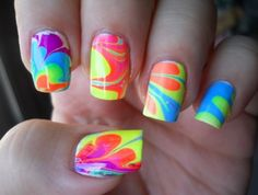 water at room temp, put in drops of nail polish, make designs with toothpick, dip in dry nails painted white.