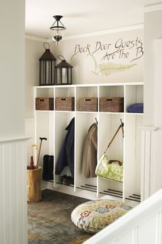 Love this mudroom, especially the quote, umbrella stand and dog bed.