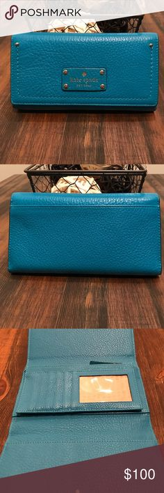 🎀EUC Kate Spade Wallet🎀 Absolutely love this color! You don't see many people carrying it and I've received so many compliments on it. In EUC with several card slots and side pockets. Coin pocket in center of wallet as well. If you have any questions or want additional pictures please let me know and I am open to offers! kate spade Bags Wallets