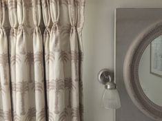 A pair of curtains in Barneby Gates Palm linen can transform a functional bathroom into a serene living space. #bathroominspiration #bathroomcurtains