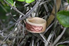 Blonde maple band with hand embossed Celtic knot in copper plate inlay. Made this for one of my nephews.