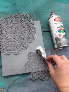 spray-painted doily canvas