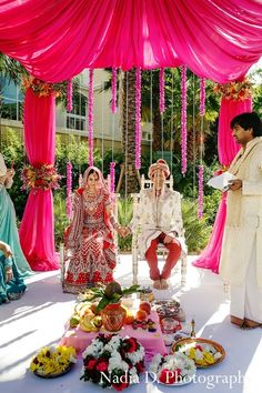 This Indian wedding ceremony is filled with bright, cheery floral and decor!