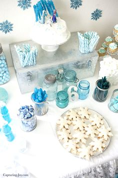 Frozen party table decorations with cookie cutter sandwiches and blue candies