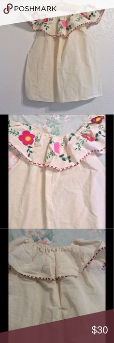 Vintage Floral off the shoulder top Beautiful vintage off the shoulder top with colorful embroidered flowers. This is in very good condition. There is no label or care tag. The material feels like linen. Vintage Tops