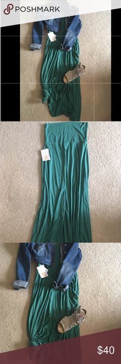 HUNTER GREEN LULAROE MAXI SKIRT NWT! ❤️ XS Lularoe Maxi skirt NWT. Pictures are not true to color as it is more of a hunter green color. Super cute knotted on bottom or just  flowy. ❤️ I wear my maxi skirts as a maxi dress- unfold the waistband and throw over a jean jacket if you prefer 😃 LuLaRoe Skirts Maxi