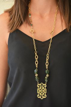 Long statement necklace with dark green stones and gold pendant and gold link chain by ExVoto Vintage Jewelry