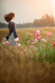 In a windy wildflower field.