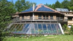~ greenhouse ~  love the shape of the solar panels ~