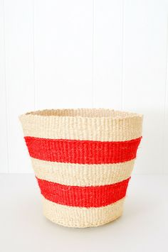 Striped Basket - These versatile baskets are handwoven from strands of natural and hand dyed sisal, by female artisans in rural Kenya. Useful as small storage baskets, office or bathroom wastebaskets or as an exterior cover for potted plants. Baskets can easily be reshaped by lightly spraying with water and molding into shape. Fair Trade - www.koromiko.com