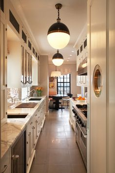 Fun nautical galley kitchen with pendant lights