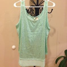Hi low top size XL Hi low top size XL . 65% polyester 35% rayon.  Sequin in front. Never been worn. Very light and comfortable to wear. Color light green. Open to any reasonable offer  Tops Tank Tops