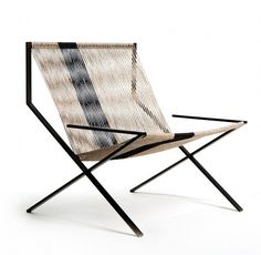 The chair above was designed and made by Dominique Houriet, who sells stunning minimalist furniture on Etsy. This chair, the Lo Ball Modern Classic, is made from antiqued steel and hand-roped natural hemp cord.
