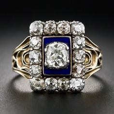 """An amazingly perfect and pristine original Georgian diamond ring dating from the early nineteenth century. In fact, it's inscribed on the back - """"W.P.J. Master died 21 Dec 1818 Aged 86"""". This ravishing rarity features a .35 carat antique cushion-cut diamond radiating from within a silver collet setting against a dramatic cobalt blue enamel background, all of which are framed by glistening table-cut diamonds - totaling 1.00 carat."""