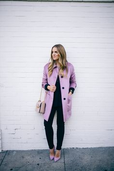Black jeans make the perfect match to a brightly coloured coat, such as this lilac Burberry number worn by Julia Engel. Try something similar with a statement coat or jacket and matching heels for a stylish winter look. Coat: Burberry, Sweater: Vince, Jeans: Frame, Pumps: Louboutin, Bag: Lanvin.