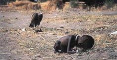 "In March 1993, while on a trip to Sudan, photographer Kevin Carter was preparing to photograph a starving toddler trying to reach a feeding center when a vulture landed nearby. Carter later said that he waited 20 minutes to see if the vulture would flare its wings. He finally took a picture and then chased off the vulture.  However, he came under criticism for failing to help the girl: The St. Petersburg Times in Florida said this of Carter: ""The man adjusting his lens to take just the right..."