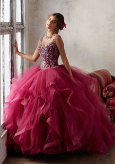 Stunning Tulle Quinceañera Ballgown Combines an Exquisitly Beaded V Neck Bodice with a Dreamy Flounced Skirt. Keyhole Corset Back. Matching Stole Included