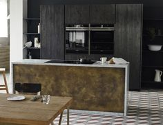 Beautiful black kitchen with a rich brushed brass kitchen island