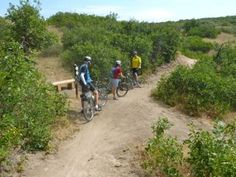 Mountain bikers gather at trail intersection on the Longhorn Ledge Trail south of Denver, CO.