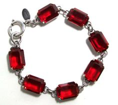 Catherine Popesco Sterling Silver Plated Bracelet with Siam (Red) Swarovski Crystals Catherine Popesco. Save 5 Off!. $99.95. Designed by Catherine Popesco. Vintage Designer Style with antique metal finish. Sterling silver plated link bracelet with Siam Red Swarovski crystals. 7.5 inches long with extender