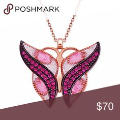 925 Sterling Silver Fuchsia Butterfly Necklace 925 Sterling Silver with Zircon Stone. Width is 25mm, height 23mm, weight is 0.14 oz. Chain length is 17.7 inches. Made in Turkey. Rosary Jewelry Necklaces