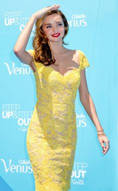 Sexy supermodel Miranda Kerr looking radiant in a bright yellow lace dress.