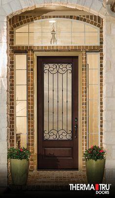 "Therma-Tru 8'0"" Classic-Craft Mahogany Collection fiberglass door with Borrassa wrought iron decorative glass."